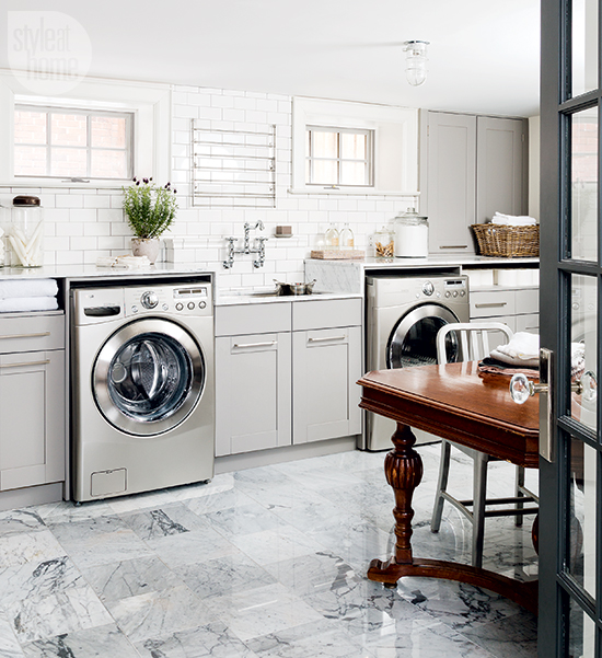 Gray laundry room with stainless steel pull down drying Basement laundry room remodel