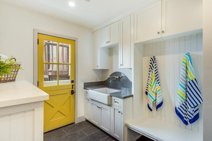 laundry room and mudroom combo with yellow door cottage laundry