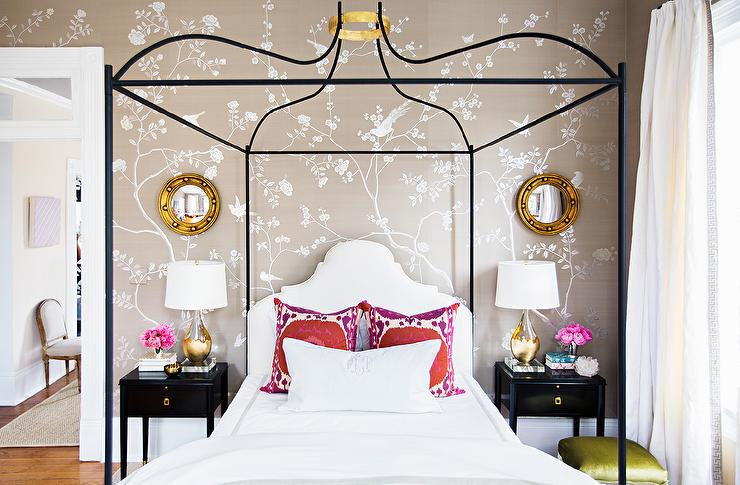 A Black Canopy Bed Boasts A Gold Halo Held Above A Bed Dressed In Gray  Border Bedding Accented With A Monogrammed Lumbar Pillow, White Shams And  Red Suzani ...