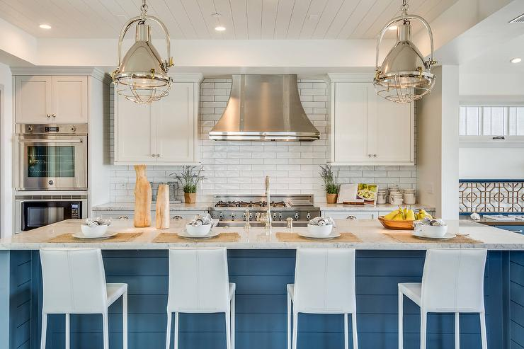 Blue Shiplap Kitchen Island With Industrial Counter Stools