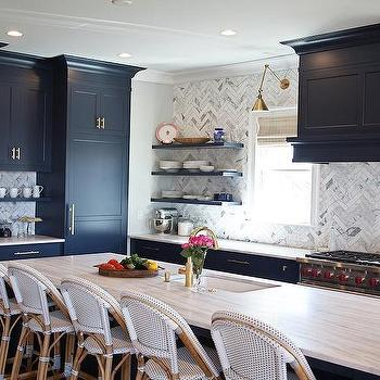 navy blue kitchen with floating shelves transitional