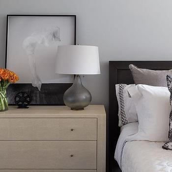 Black Wood Bed With Blond Dresser As Nightstand And Smoke Gray Glass Lamp