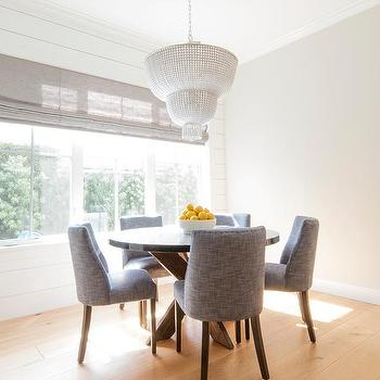 Round Zinc Top Dining Table With Charcoal Gray Chairs And Aerin Jacqueline Two Tier Chandelier