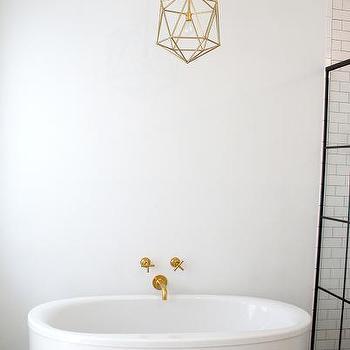 Kohler Oval Tub With Kohler Purist Bathtub Faucet And Gold Polyhedron Light  Pendant