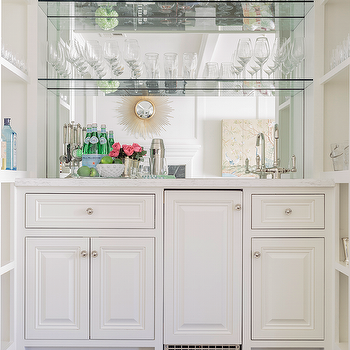 Mirrored Wet Bar Flanked By Built In Shelves