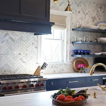 Navy Lower Kitchen Cabinets With Long Brass Pulls