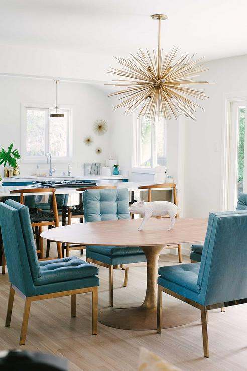 Peacock Blue Leather Tufted Dining Chairs with Oval Dining Table and Brass  Sputnik Chandelier. Peacock Blue Leather Tufted Dining Chairs with Oval Dining Table