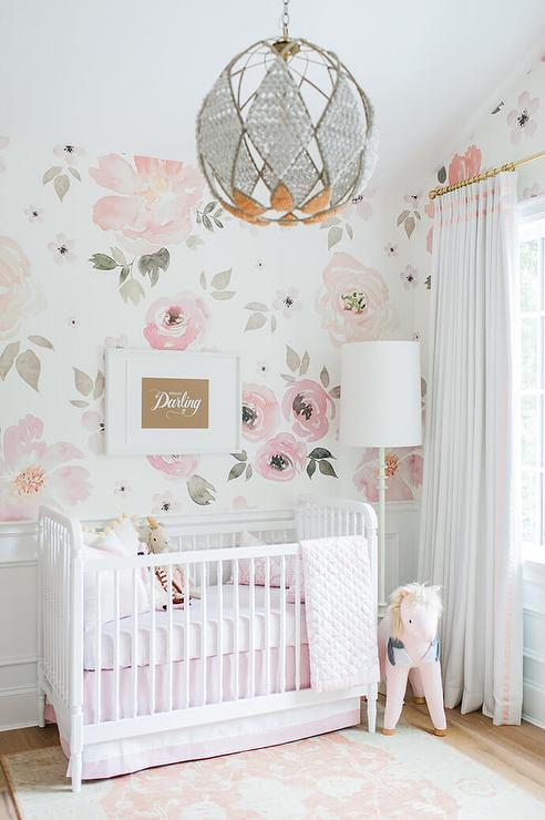 White beaded orb nursery chandelier design ideas adorable pink and white girls nursery clad in jolie wallpaper on the upper walls and wainscoted lower walls features a jenny lind floor lamp lighting a aloadofball Choice Image
