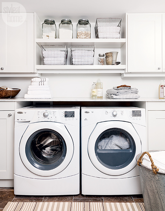Washer And Dryer Tucked Under Marble Countertop