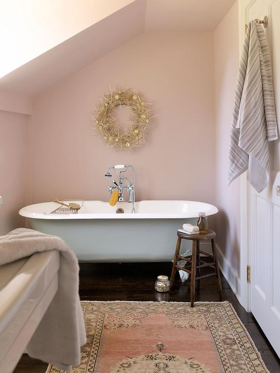 Pink Country Bathroom With Clawfoot Tub Under Sloped
