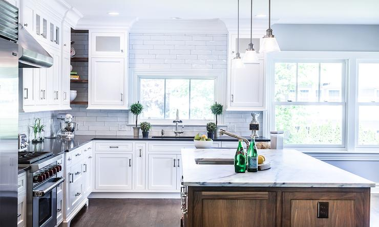 Well Designed Large Transitional Kitchen Features A Walnut Kitchen Island Topped With Honed Gray And White Marble Countertops Holding An Undermount Prep