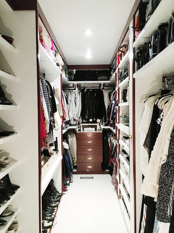 Long And Narrow Closet Features A Sweater Shelf Over Clothes Rails And A  Built In Dresser Alongside A Floor Safe.