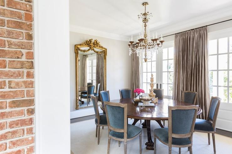 French Dining Room With Round Table And Blue Velvet Chairs