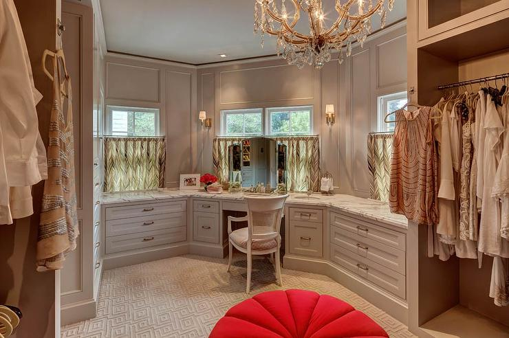Delightful Gray Walk In Closet Features Gray Built Ins Fitted With A Makeup Vanity And  A White Cane Back Chair Placed Under A Window Dressed In Cafe Curtains.