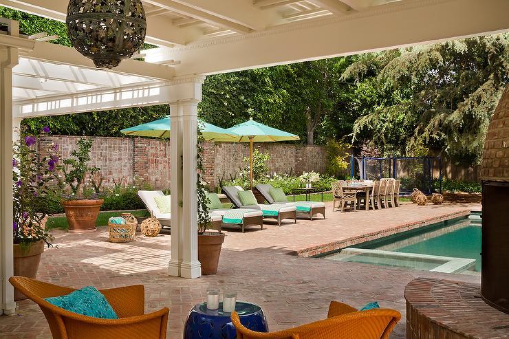 Gray Pool Loungers and Aqua Umbrellas - Traditional - Deck/patio