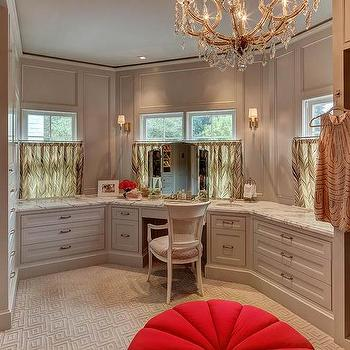 Elegant Gray Walk In Closet With Makeup Vanity Below Window