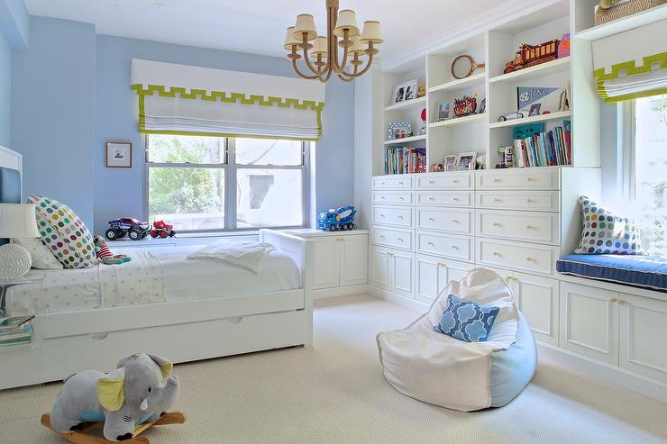 Blue boy bedroom with white built in dressers and brass for Blue and white boys room