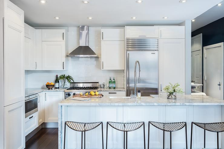 White Kitchen Cabinets With Gray And Marble Countertops