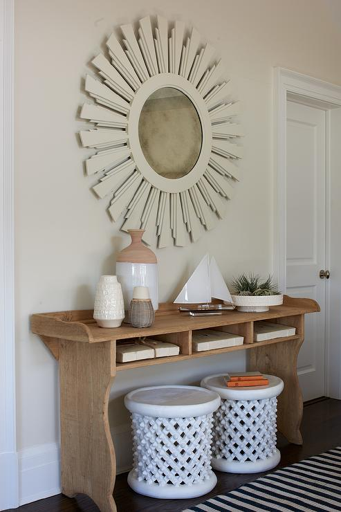 Cottage Foyer With Cream Sunburst Mirror Over Console Table With Shelves