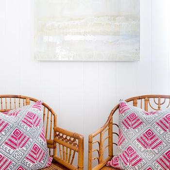 Rattan Chairs With Hot Pink And Gray Pillows