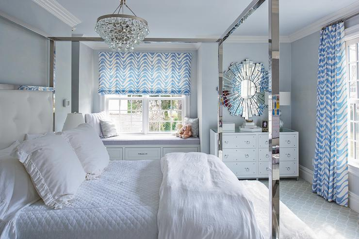 white and blue bedroom with stainless steel canopy bed transitional