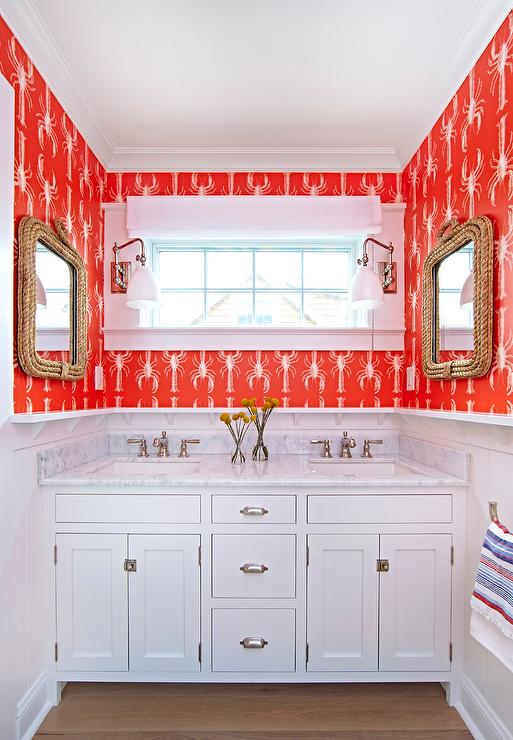 white and red kids bathroom with red lobster print wallpaper
