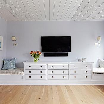 Beach Bungalow Bedroom With TV Over Built In Dresser