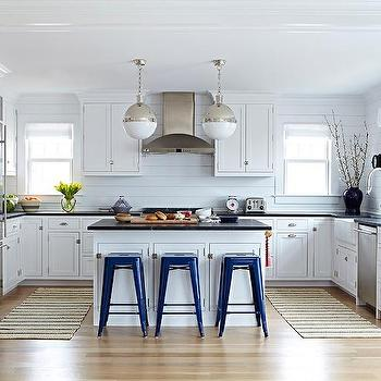 White Beach Bungalow Kitchen With Navy Blue Tolix Stools