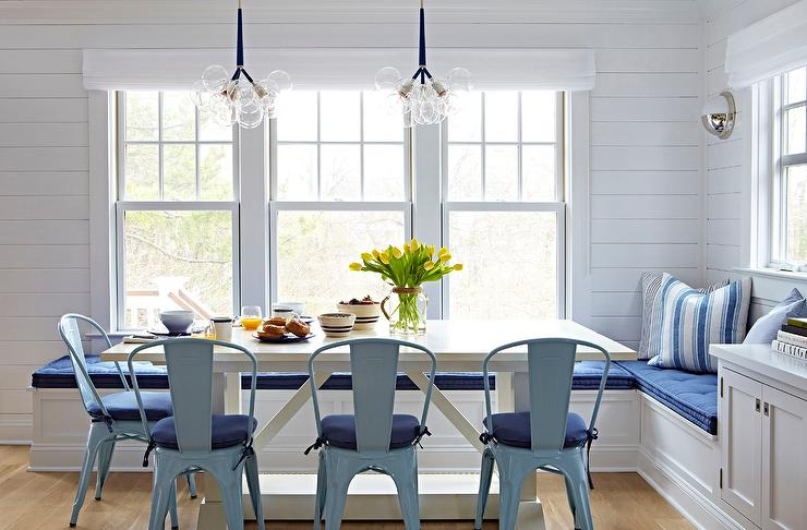 Beach Bungalow Dining Room With Blue Tolix Chairs And White Trestle Table