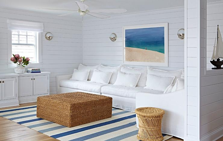 White And Blue Beach Bungalow Living Room With Seagrass Ottoman As Coffee Table
