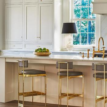 Long Cream Kitchen Island With Gold And Gray Counter Stools Transitional Kitchen