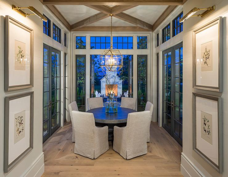 Glass Dining Room with Round Zinc Top Dining Table Transitional