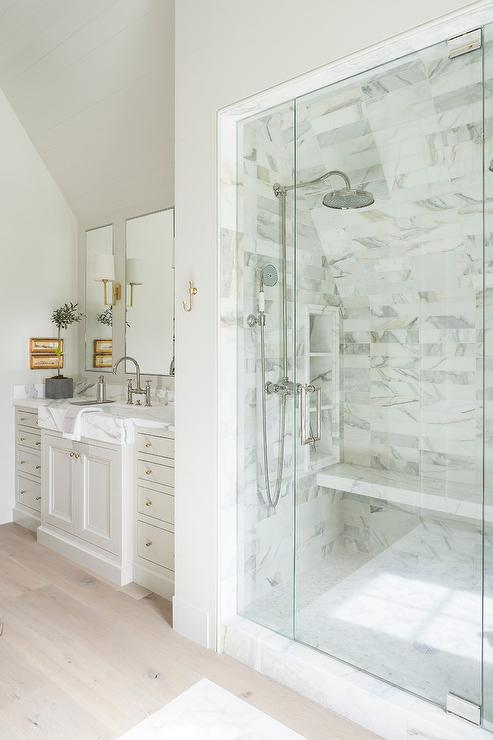 Glass Walk In Shower With Sloped Ceiling Over Marble