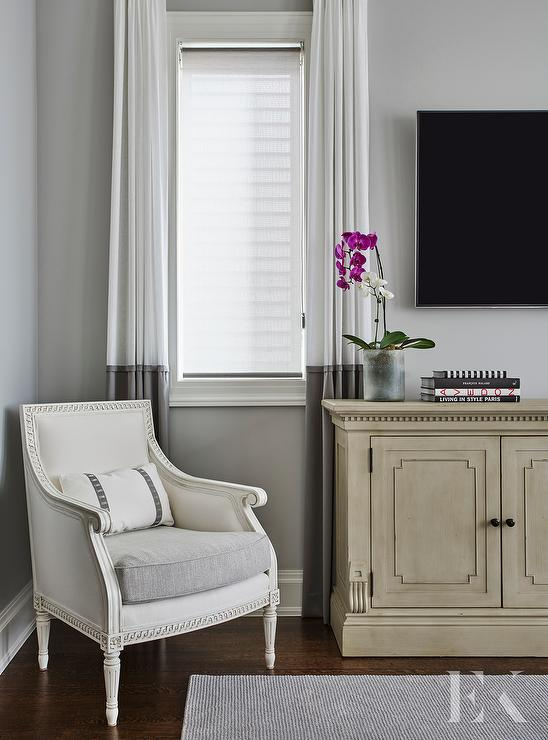 Master Bedroom With French Tv Cabinet And White And Gray Curtains