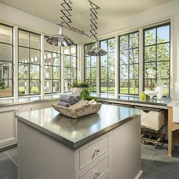 laundry room lighting ideas. light gray laundry room cabinets with zinc countertops lighting ideas