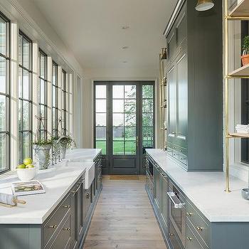 Gray Butler Pantry Cabinets Under Casement Windows