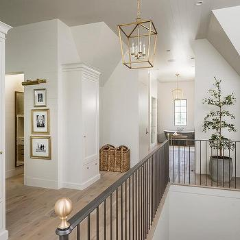 Wonderful Second Floor Landing With Iron Staircase Railing And Brass Finials