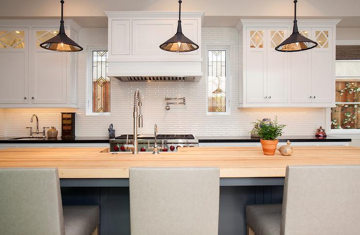 Gray Kitchen Island With Maple Countertops And Light Gray
