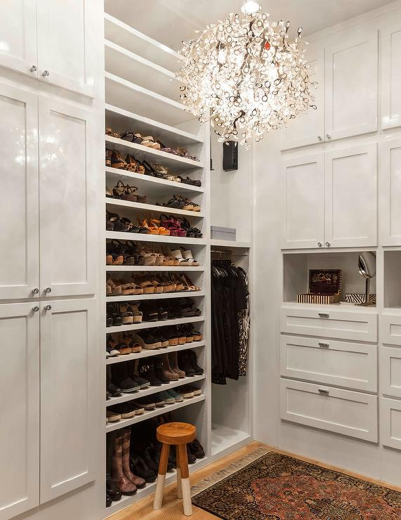 Walk in closet with tilted shoe shelves transitional for Walk in shoe closet