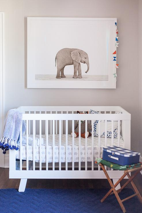 white and blue nursery with baby elephant print over oeuf sparrow crib