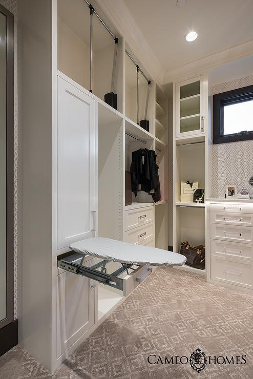 White And Gray Closet With Hidden Drop Down Ironing Board
