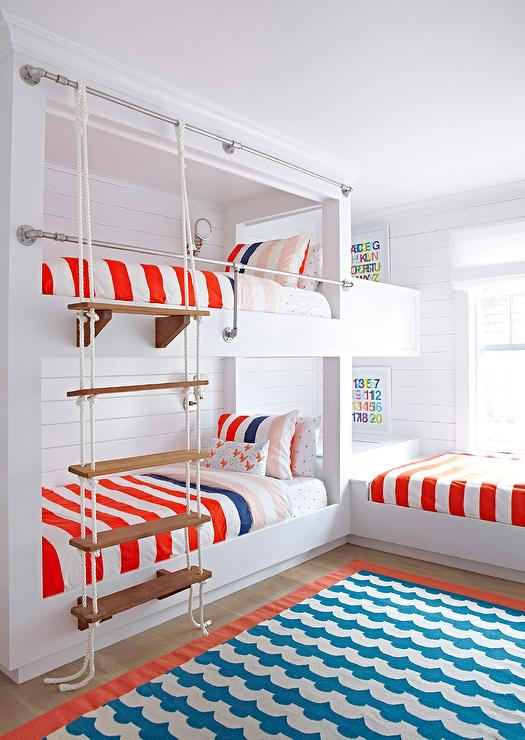 Red  white and blue boys  room features built in shiplap bunk beds dressed  in red  white and blue bedding accented with a white rope ladder as well as  a. Reclaimed Wood Rope Hanging Bunk beds   Mediterranean   Girl s Room