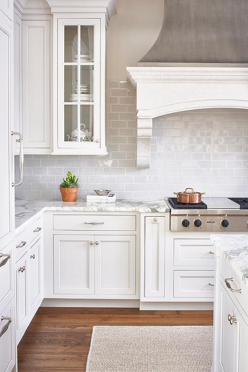 White And Gray Kitchen Features A Zinc French Kitchen Hood With Corbels Stands Over A Gray Mini Subway Tile Backsplash And An Integrated Stainless Steel
