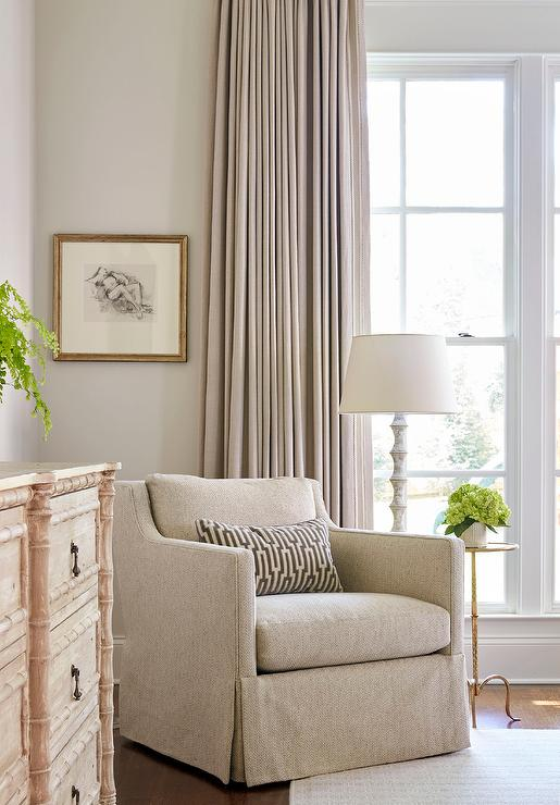 Elegant Bedroom Reading Corner With Skirted Herringbone Chair And  Whitewashed Floor Lamp