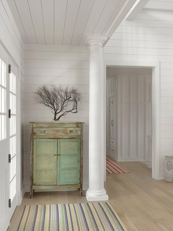 Cottage Foyer With Green Distressed Cabinet And Sea Fan Statue