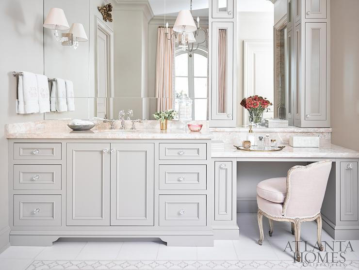 ... Gray Walls Framing A Light Gray Washstand Accented With Glass Knobs And  Pink Marble Countertops Placed Beneath A Frameless Vanity Mirror Lit By  Mirror ...