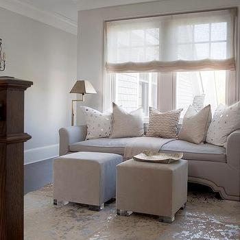 Gray Sofa With Brass Nailhead Trim And Mirror Tile Pillows