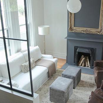 living room pendant light. White Slipcovered Roll Arm Sofa with Gray Velvet Cube Ottomans Glass Globe Living Room Pendant Light Design Ideas
