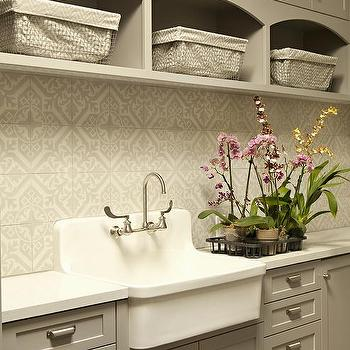 Gray Laundry Room Cabinets with Vintage Pulls and Apron Sink