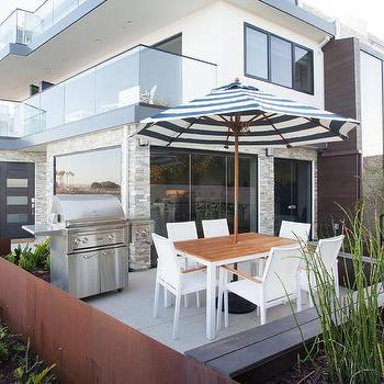 California Beach Style Patio With Black And White Striped Umbrella